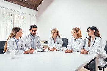 Team of doctors having a meeting in the clinic. Copy space.