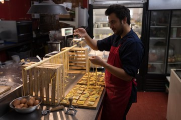 Baker preparing handmade pasta