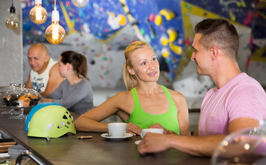 Couple drinking coffee at bouldering gym