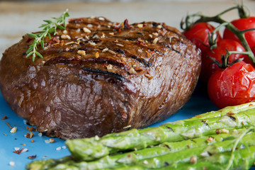 beef steak grilled with asparagus, tomatoes, spice