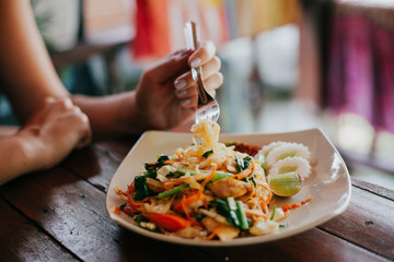 Tasty thai food with noodles and vegetables