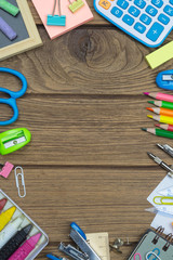 Ideal for back to school, education and  office work background concept. School supplies, stationery accessories on wood background. Top view with copy space.