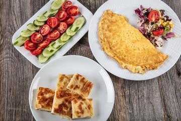 Tomato, Cucumber, Omelette, breakfast pastries.