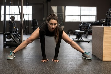 Woman doing stretching exercise in fitness studio