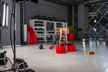 Behind the scenes of video production or video shooting of woman in sportswear doing crossfit