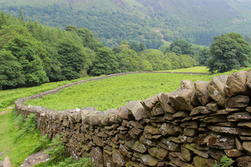 Landscape of dry stone wall across the fields in Wales UK