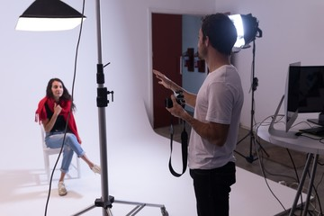 Male photographer and female model interacting with each other