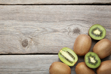 Kiwi fruits on grey wooden table