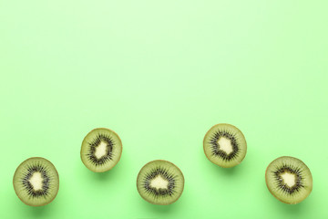 Kiwi fruits on green background
