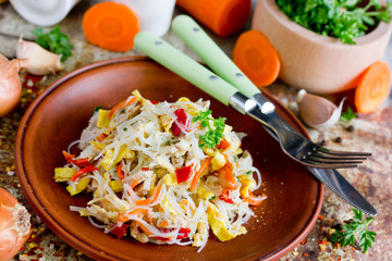 Chicken pad thai rice noodles with fried egg, onion, carrot, pepper