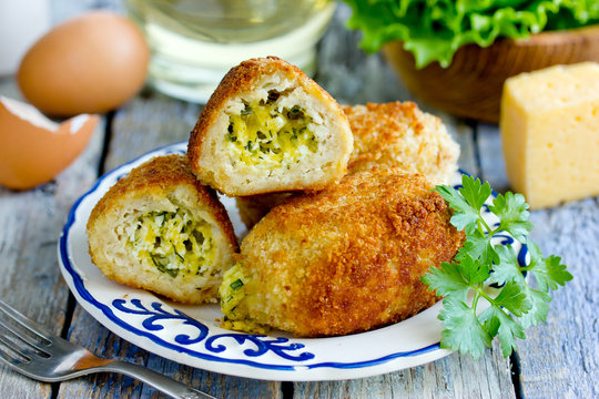 Chicken cutlets with cheese, egg, parsley, butter filling. Traditional russian food zrazy