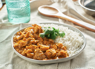plate of indian curry with basmati rice and chicken
