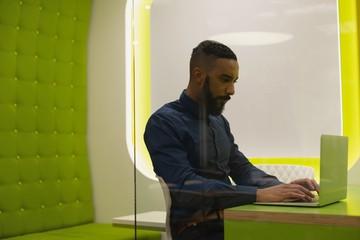 Businessman using laptop in desk