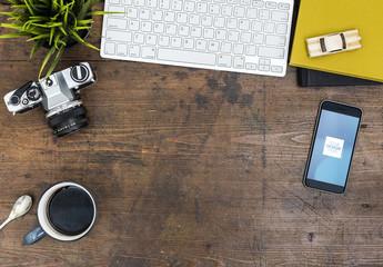 Smartphone on Wooden Desk Mockup