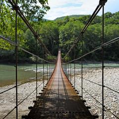 Suspension bridge through river Belaya in Republic of Adygea, Russia