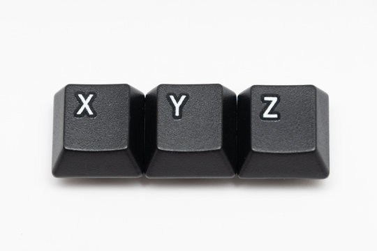 Single black keys of keyboard with different letters XYZ