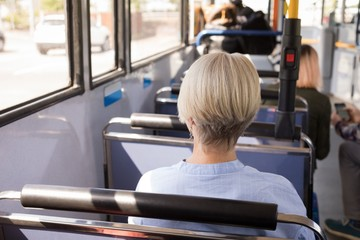 Woman travelling in modern bus