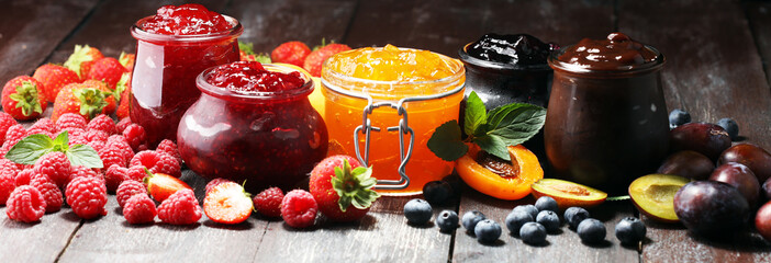 assortment of jams, seasonal berries, apricot, mint and fruits. marmalade or confiture Wall mural