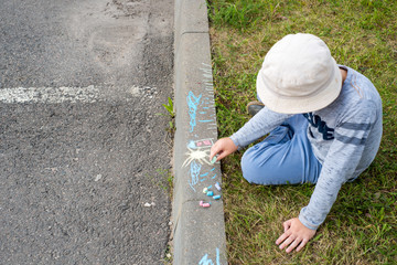 children's drawings with crayons on the pavement