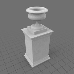 Stone urn on pedestal