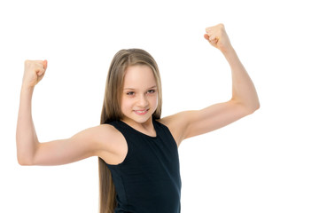 A little girl shows her muscles.