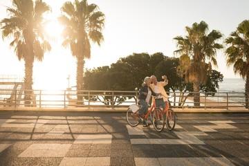Senior couple taking selfie at promenade
