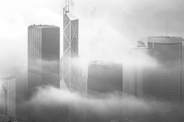 Fototapete - Misty and Cloudy view at Hong Kong in B&W color