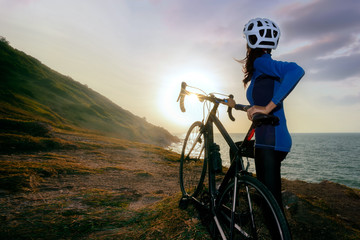 Mountain Bike cyclist standing on top of a mountain with bicycle .Extreme sport concept