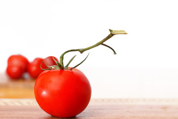 Red Tomatoes Against a White Background