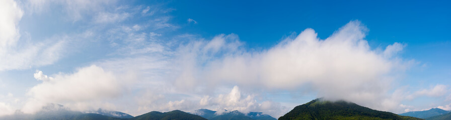 wonderful dynamic cloudscape above the mountain ridge. beautiful panoramic nature background