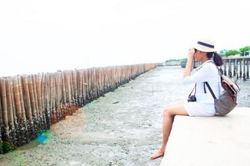 Asian woman traveler using binoculars, Travel lifestyle