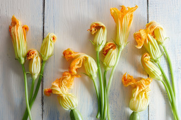 Courgette flowers on wooden background