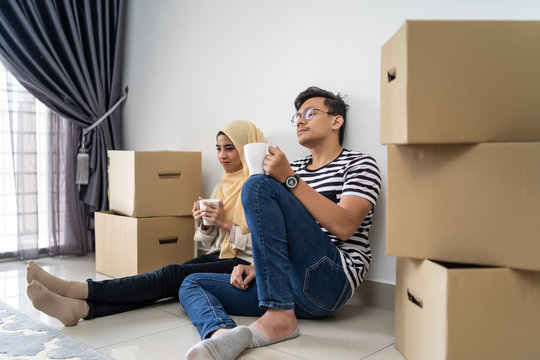 asian couple moving house together with box
