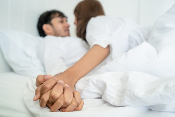 Romantic love of young couple in the bedroom.