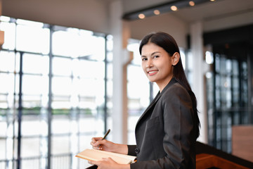 Business concept. Young businesswoman is working hard.