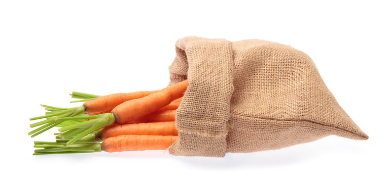 fresh baby carrot in sack  isolated on white background.