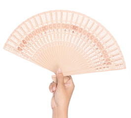 hand holding beautiful fan isolated on white background