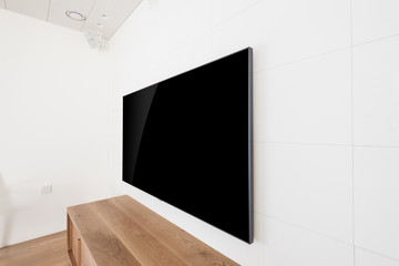 television side view in a white interior
