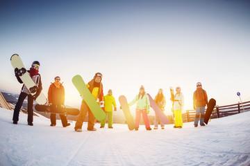 Happy friends snowboarders at ski resort