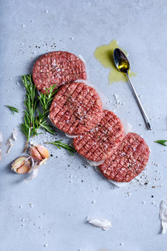 Raw burger cutlets, ground beef meat with spices