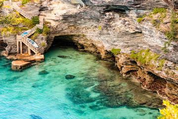 Paradise travel destination beach in Hamilton, Bermuda. Deep Bay Beach with golden sand and a beautiful rock formation.