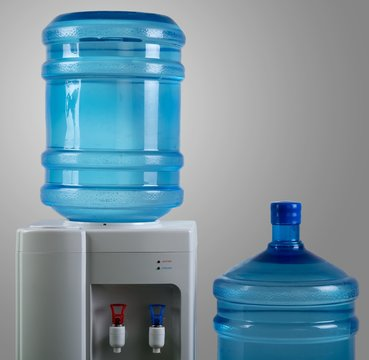 Water Dispenser with Two Big Water Bottles on the Grey