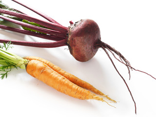 Fototapete - Carrots and beets, isolated on white background, top view. The concept of a new crop, healthy food.