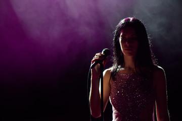 close up image of live singer on stage