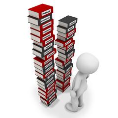man looking at book pile