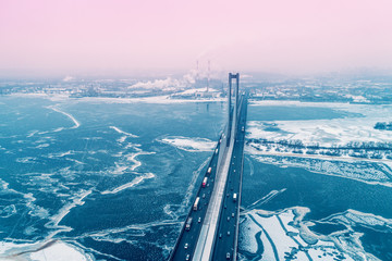 Printed kitchen splashbacks Kiev Skyline, Kiev city in the blizzard in the early morning. Aerial view from the left bank of the Dnieper River at The Pivdennyi (Southern) Bridge