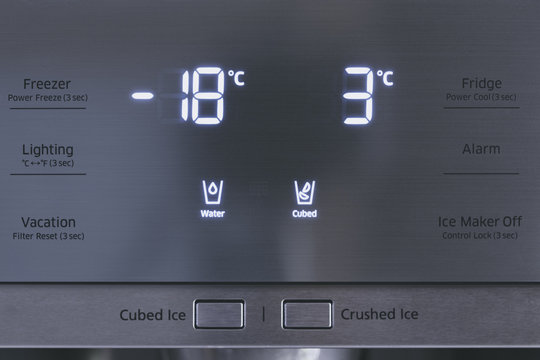 Steel modern touching panel of fridge water and ice dispenser.