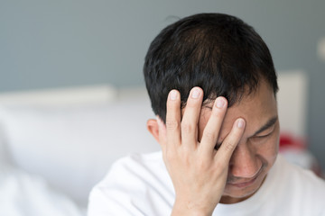 Migraine symptoms in businessman. Man suffering from pulsating pain of one sided headache. People medical healthcare concept
