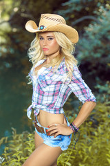 Sexy cowgirl posing