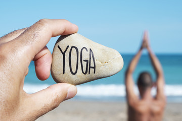 yogi man and text yoga in a stone